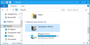 Locate your iPhone in the storage devices present in the This PC sub-menu